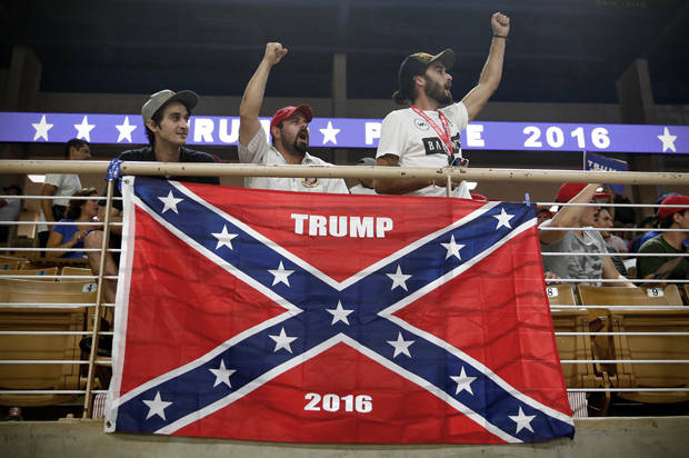 Brandon Miles, Brandon Partin and Michael Miles cheer before Republican U.S. presidential nominee Donald Trump attends a campaign rally at the Silver Spurs Arena in Kissimmee, Florida
